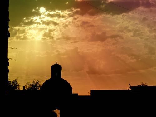 sunset sky building rainbow colours silhoettes uzbekistan bukhara crepuscular