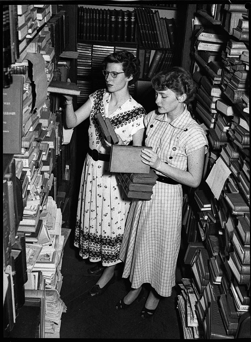 Library confusion, 23/12/1952, by Sam Hood