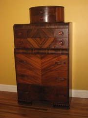 drawer(1.0), furniture(1.0), wood(1.0), chiffonier(1.0), cupboard(1.0), wood stain(1.0), chest of drawers(1.0), chest(1.0), wood flooring(1.0), hardwood(1.0), cabinetry(1.0), flooring(1.0),