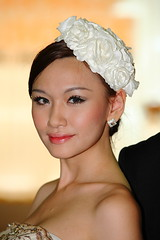 veil(0.0), bridal veil(0.0), gown(0.0), hat(0.0), bride(1.0), face(1.0), hairstyle(1.0), model(1.0), clothing(1.0), head(1.0), hair(1.0), woman(1.0), fashion(1.0), headpiece(1.0), beauty(1.0), headgear(1.0),