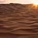Sunrise on a sea of sand by Sarah Ann Wright
