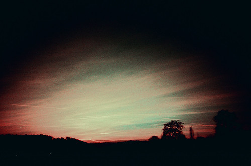 sunset sky film analog schweiz switzerland lomo lca xpro crossprocessed suisse silhouettes slidefilm april analogue vapourtrails 2011 agfarsxii kestenholz lomographylca autaut april2011 lomographyxproslidefilm lomoxpro200