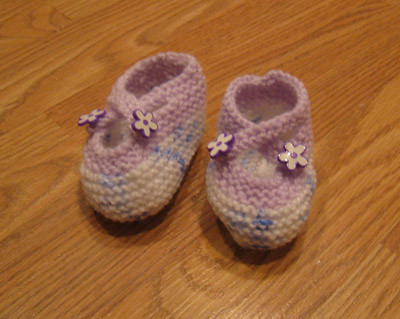 Baby botties with flower buttons