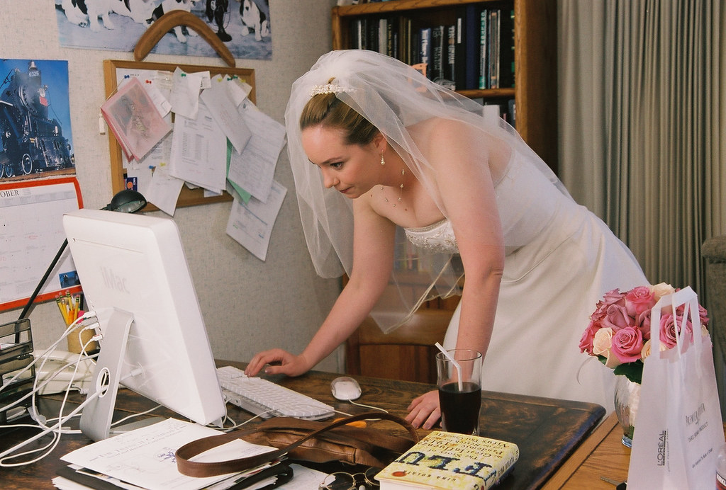 Bride checking the internet III