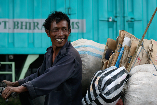 Hard working, yet smiling man in Kupang, Indonesia.