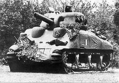 armored car(0.0), combat vehicle(1.0), weapon(1.0), vehicle(1.0), tank(1.0), self-propelled artillery(1.0), gun turret(1.0), churchill tank(1.0), land vehicle(1.0),
