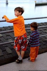 brothers enjoying a balcony view of yaquina bay    M…
