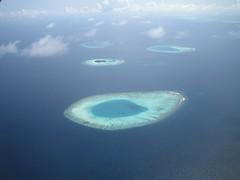 marine biology(0.0), underwater(0.0), reef(0.0), archipelago(1.0), atoll(1.0), sea(1.0), ocean(1.0), island(1.0), azure(1.0), wind wave(1.0),