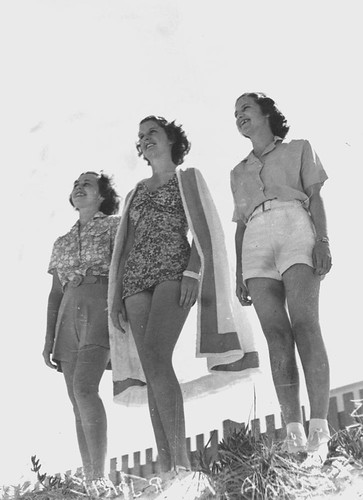Mina Tucker, Marie McKenna and Marjorie Ramsey displaying beach fashions at Southport, 1938