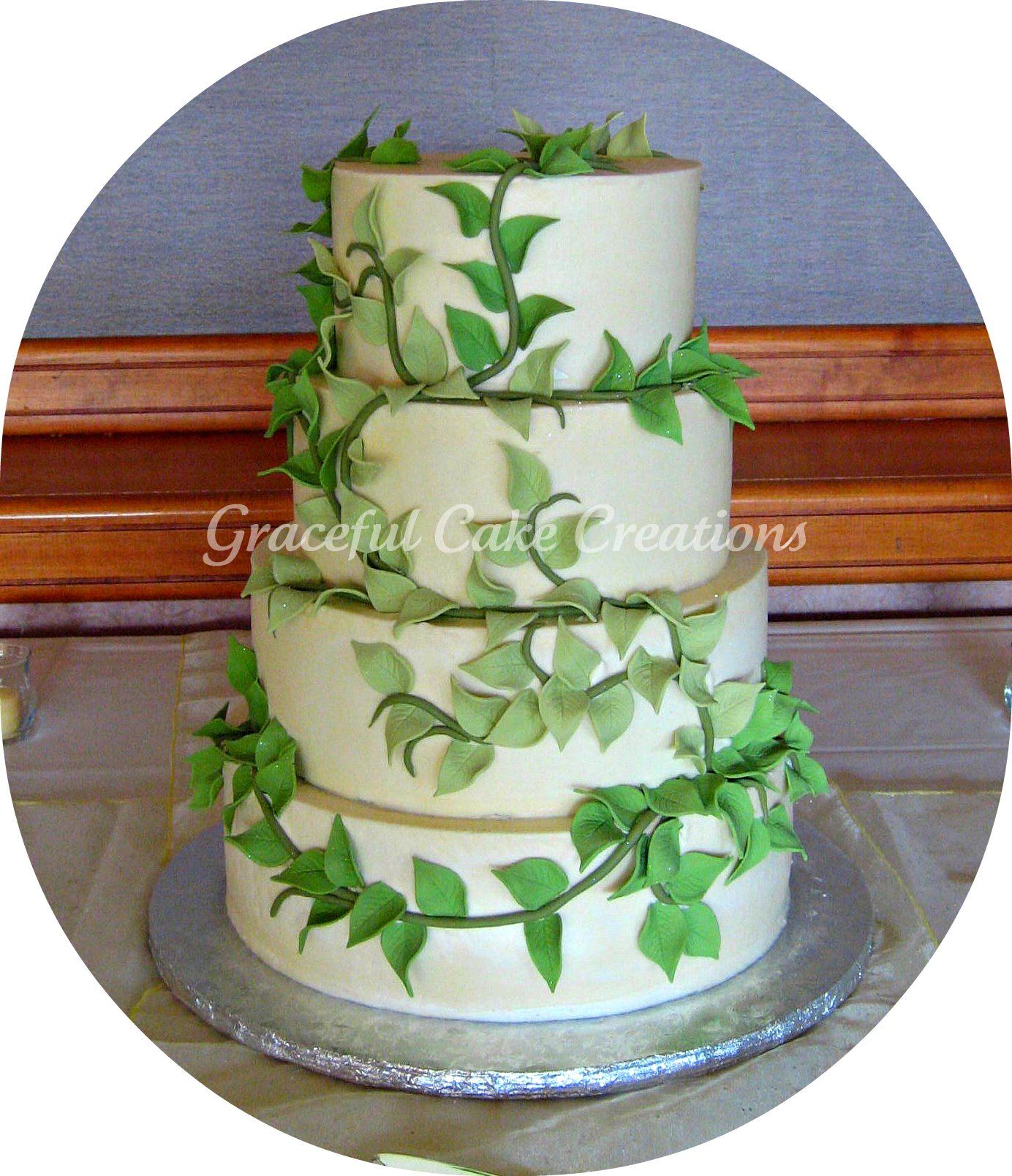 Elegant Ivory Wedding Cake with Green Leaves
