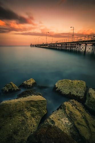 longexposure sunset water clouds dock rocks seascape sea sky landscape pier cyprus sony sonya6000 ilce6000 samyang samyang12mmf20ncscs haidafilters manfrottobefree