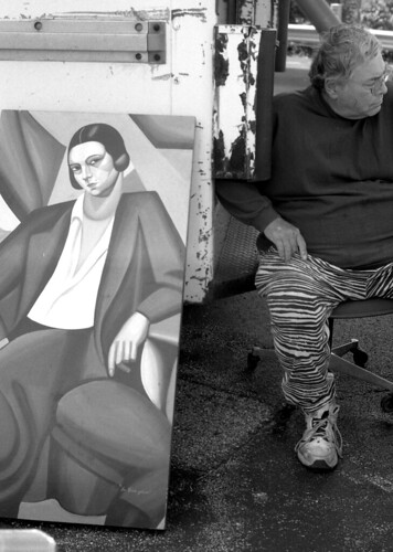 Man and painting at flea market, Rosemont, IL 2009