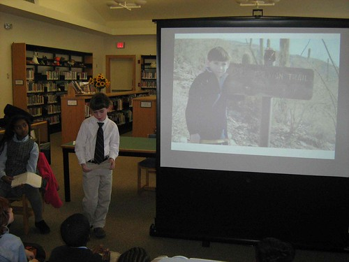 Bullis third grader telling an assembly about his trek with Buddy on the Pima Canyon Trail in Tucson, AZ