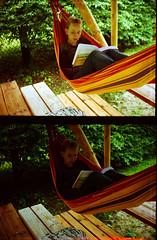 outdoor play equipment(0.0), jungle(0.0), backyard(1.0), leisure(1.0), hammock(1.0), sitting(1.0),