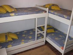 studio couch(0.0), bed frame(1.0), furniture(1.0), room(1.0), bed sheet(1.0), bed(1.0), bunk bed(1.0), bedroom(1.0),