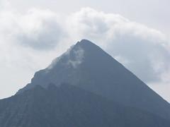 cloud, mountain, spoil tip, mountain range, hill, summit, ridge, shield volcano, mountainous landforms, volcanic landform,