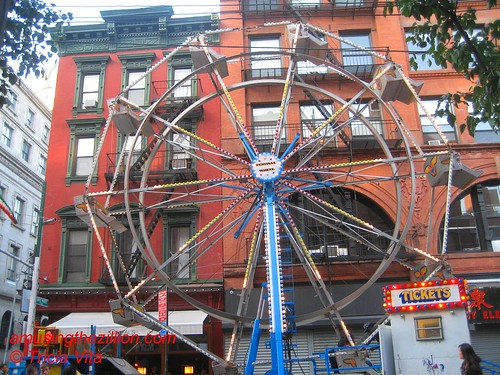 Toy Store Amusements Festival Wheel at San Gennaro. Photo © Tricia Vita/me-myself-i via flickr