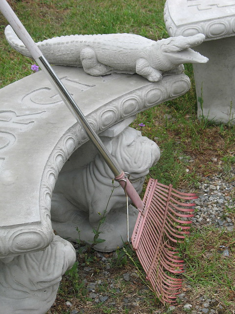 gator--the bench, held up by two bulldogs is engraved with GEORGIA
