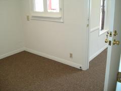 furniture(0.0), laminate flooring(0.0), bed(0.0), basement(0.0), wood flooring(0.0), floor(1.0), wall(1.0), wood(1.0), room(1.0), property(1.0), molding(1.0), interior design(1.0), hardwood(1.0), home(1.0), flooring(1.0),