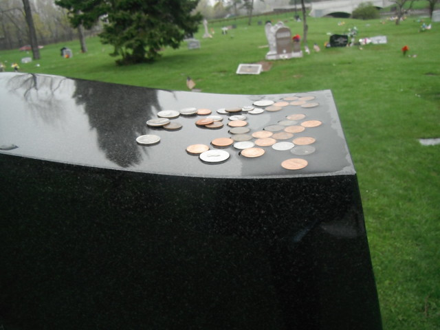 coins on military graves