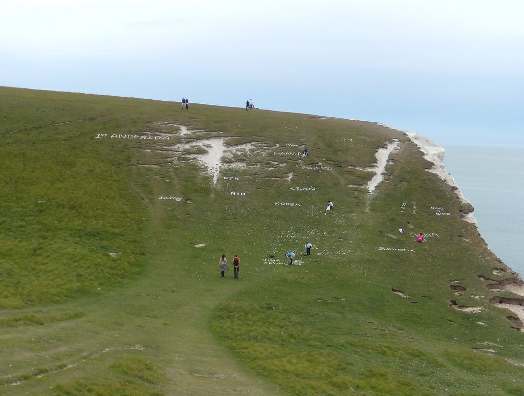 "Where do you come from? Seems to be a tradition now to write messages in pieces of chalk on this particular slope. Click ""all sizes"" to read. Seaford to Eastbourne"