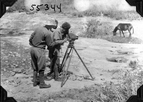 Expedition members with movie camera