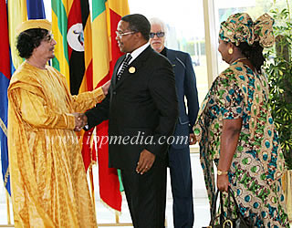 Tanzanian President Kikwete greeting African Union chair Khadafi of Libya at the AU Summit in Sirte. by Pan-African News Wire File Photos