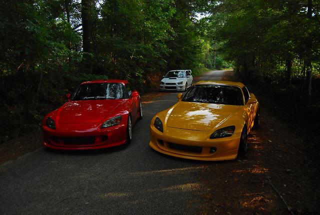 s2000, STI, in a driveway