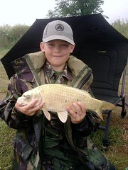 Reece McMullen with a 5lb Ghost Carp caught on Moss Lake