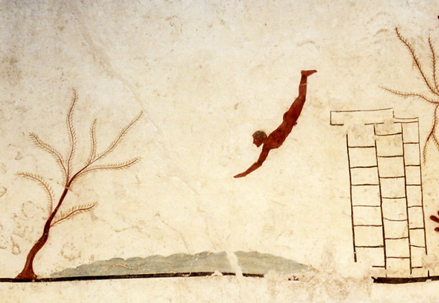 Detail from the underside of the top slab of the Tomb of the Diver, showing a man diving into waves. The frescoes are painted in true fresco on limestone slabs and are dated about 475-470 BC, National Museum of Paestum, Italy