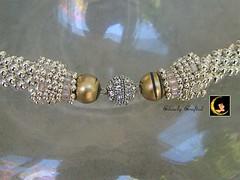 headpiece(0.0), pearl(1.0), jewellery(1.0), gemstone(1.0), bracelet(1.0),