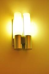 lamp(1.0), incandescent light bulb(1.0), light fixture(1.0), yellow(1.0), sconce(1.0), light(1.0), amber(1.0), lighting(1.0), brass(1.0),