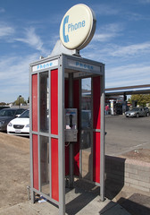 outdoor structure, telephone booth, parking, payphone,