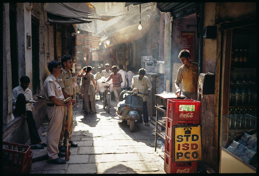 Boy Making a Dosa for Police Men, Benares/Varanasi India 2009 by lylevincent