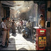 Boy Making a Dosa for Police Men, Benares/Varanasi India 2009 by lylevincent