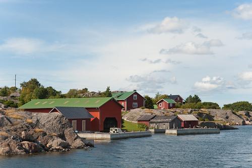 blue red sea summer sky white house building water finland island nagu suomenlahti nauvo d700 2470mmf28g utterholmen