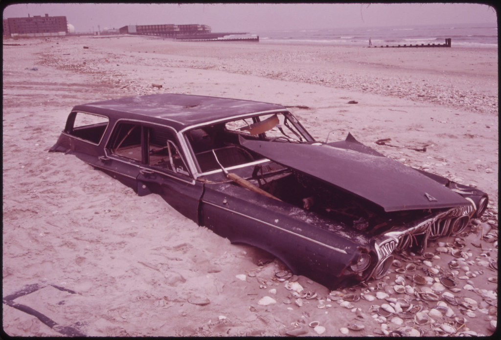 Sand Covers Abandoned Car on Beach at Breezy Point South of Jamaica Bay 05/1973