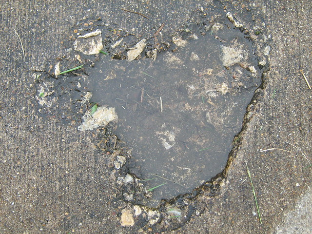 A ding in the sidewalk that looked just like a heart