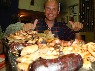 Ola with the meat feast in Salta, Argentina