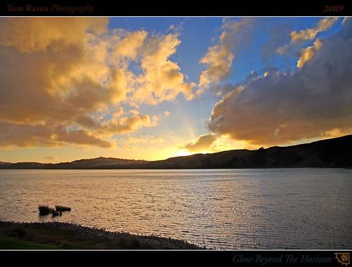 autumn sunset newzealand sky sun clouds geotagged glow framed hills inlet rays 2009 relections pauatahanui wellingtonregion pauatahanuiinlet tomraven geo:lat=41092484 geo:lon=174897972 q209
