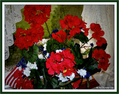 carnation(0.0), annual plant(1.0), flower arranging(1.0), cut flowers(1.0), flower(1.0), floral design(1.0), red(1.0), plant(1.0), flower bouquet(1.0), floristry(1.0),
