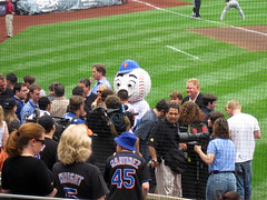 Pregame ceremony. That's Rusty Staub to the right of Mr. Met.