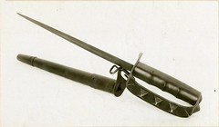 firearm(0.0), ã‰pã©e(0.0), gun barrel(0.0), fencing weapon(1.0), weapon(1.0), scabbard(1.0), sabre(1.0), dagger(1.0),