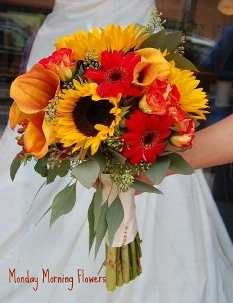 Fall Bridal Bouquet Accents of seed euc along with medium sized sunflowers