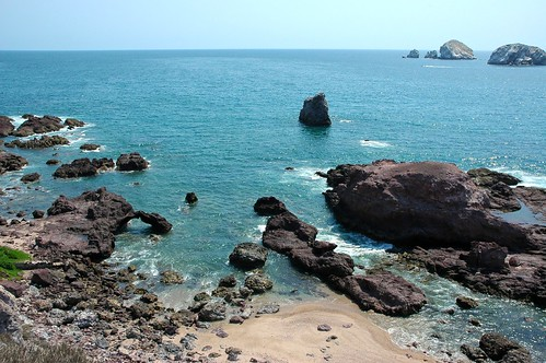 Beauty Test Beach, the little arch, with islands and speedboat, South Mazatlan, Sinaloa, Mexico by Wonderlane