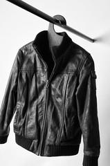 textile(1.0), leather jacket(1.0), clothing(1.0), leather(1.0), monochrome photography(1.0), jacket(1.0), monochrome(1.0), black-and-white(1.0), black(1.0),
