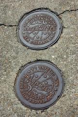 commemorative plaque(0.0), money(0.0), award(0.0), iron(1.0), manhole(1.0), manhole cover(1.0),