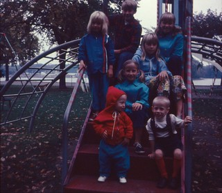 Olsen family on Miracle Jack-and-Jill (Space Ship aka rocket slide in background), Copeland Park, La Crosse, WI, Oct 1969