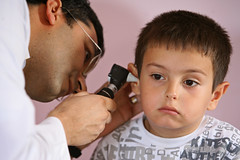 A child receives an ear exam as part of an overall health check up