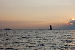 Ferry and Delaware Breakwater Light at Sunset